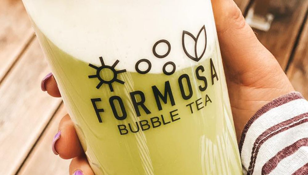 Formosa Bubble Tea Cup Close Up In Hand