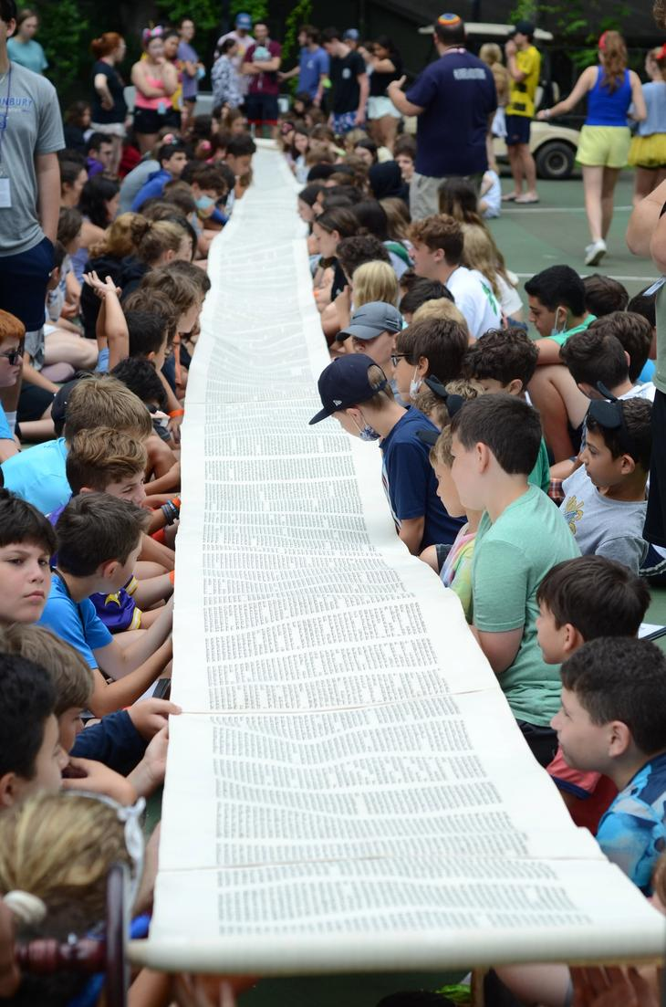Torah scroll unrolled for campers