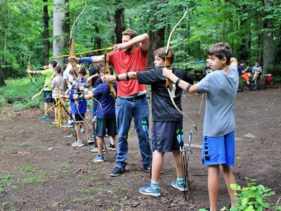 two campers hodling archery bows at Camp Laurelwood