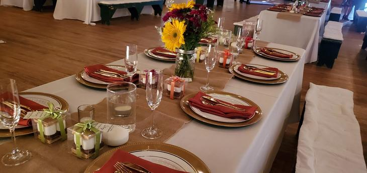 event talbe set with dishes, cutlery and flowers, waiting for event guests, at the Laurelwood Retreat Center