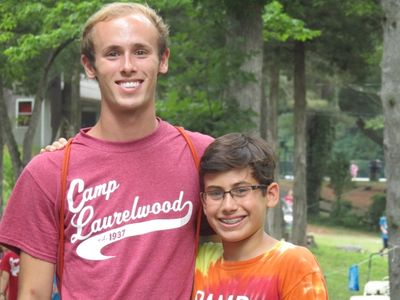male counselor and camper