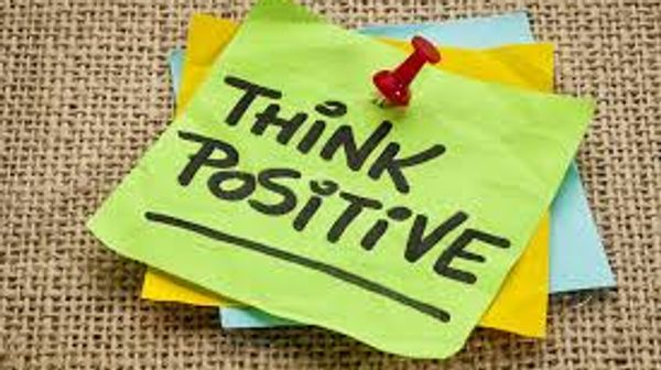 "post it notes that say ""Think Positive!"" on them"