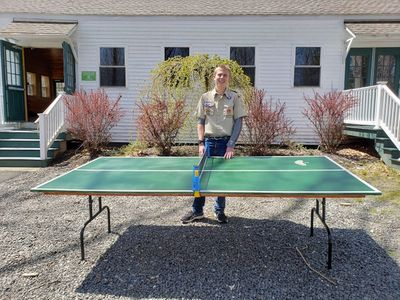Eagle Scout, Edgar, with the ping-pong table he created for CL!