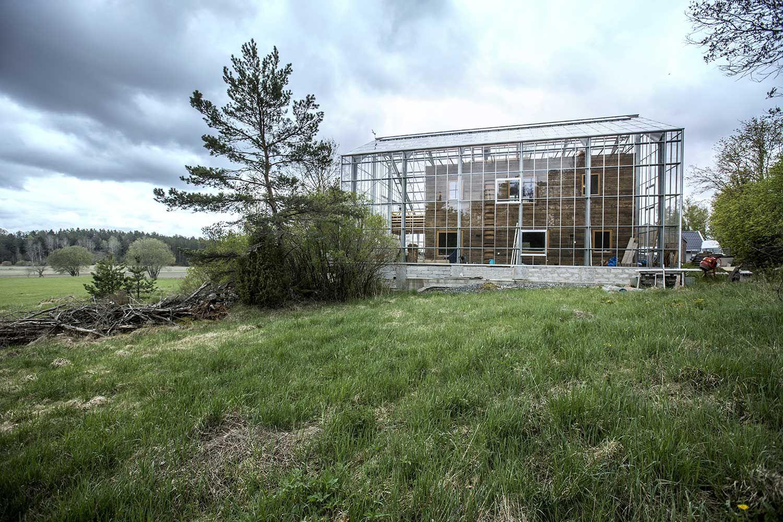 drivhus som omgir et hus