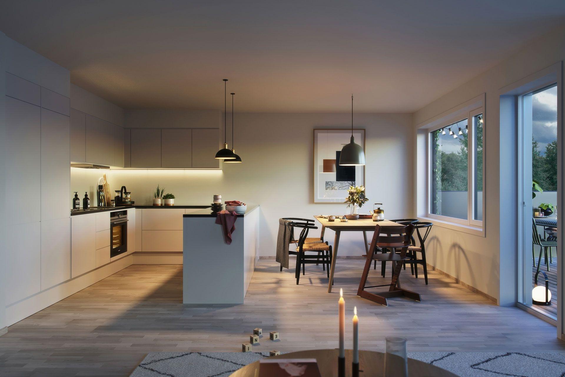 Husets kjøkken ligger i førsteetasje med utgang til balkong