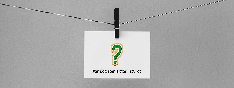 spørsmålstegn på et papir