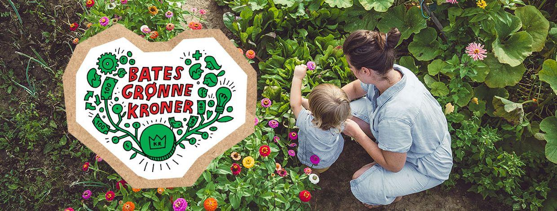 Mor og barn blant blomster og grønnsaker