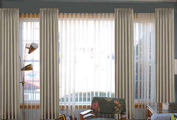 how to hang curtains over vertical blinds
