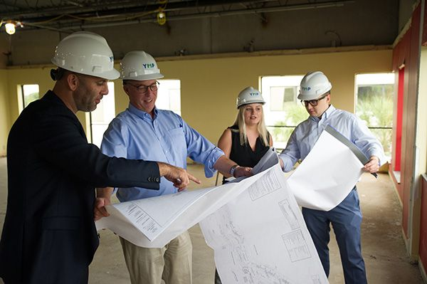 Moshe and crew looking at plans