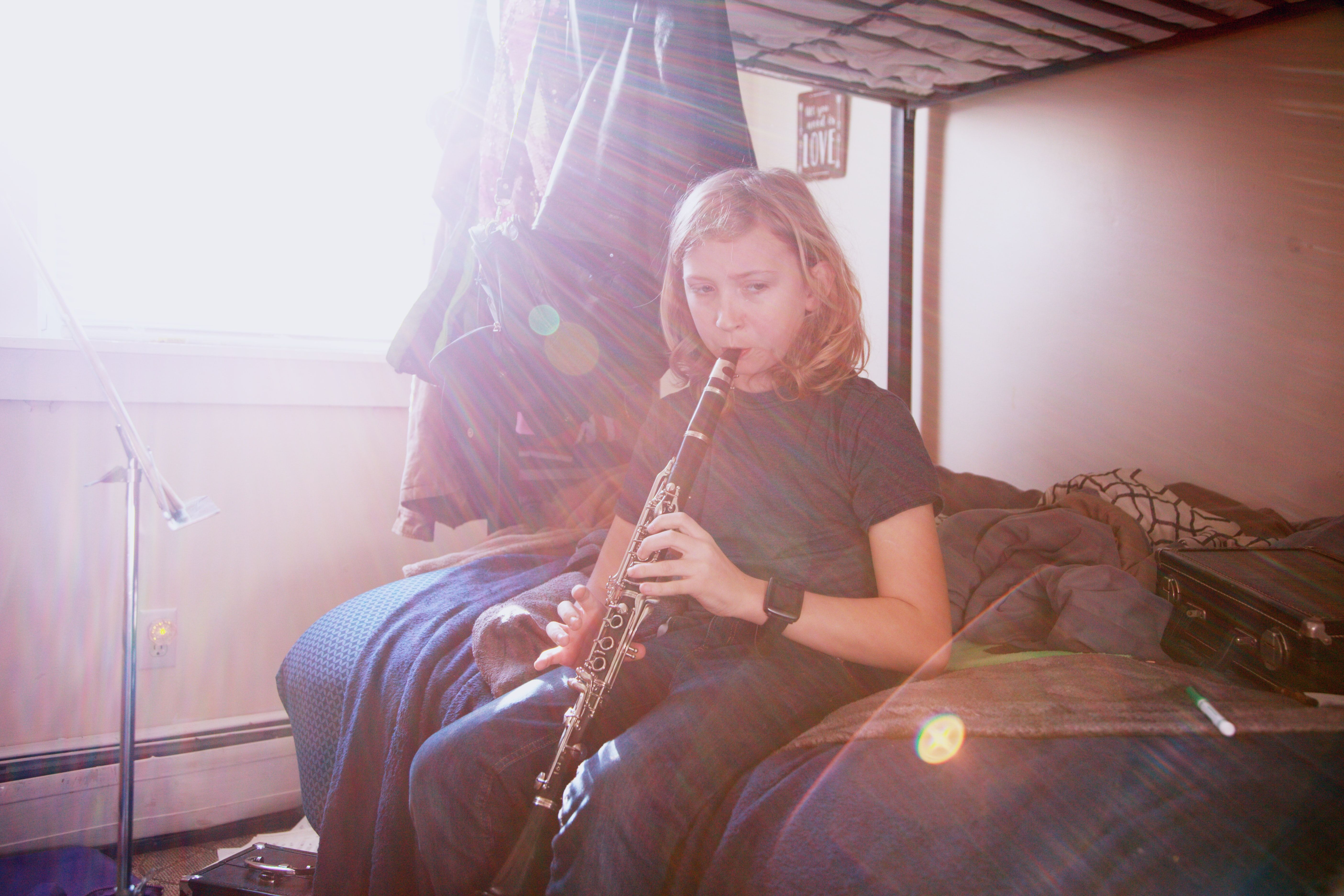 Image of a girl playing the clarinet.