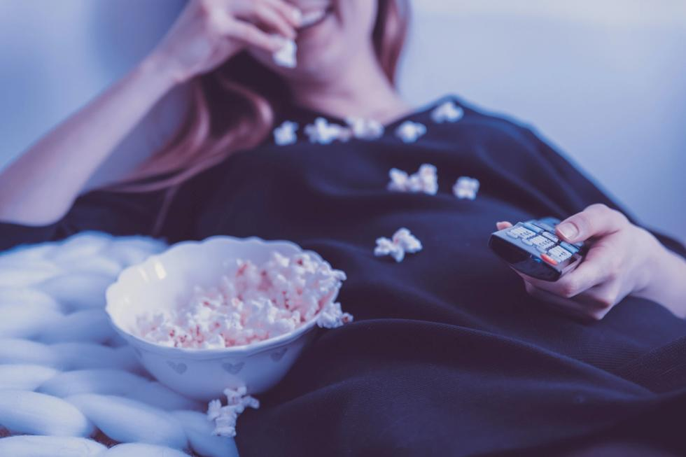 Woman eating popcorn like a champ