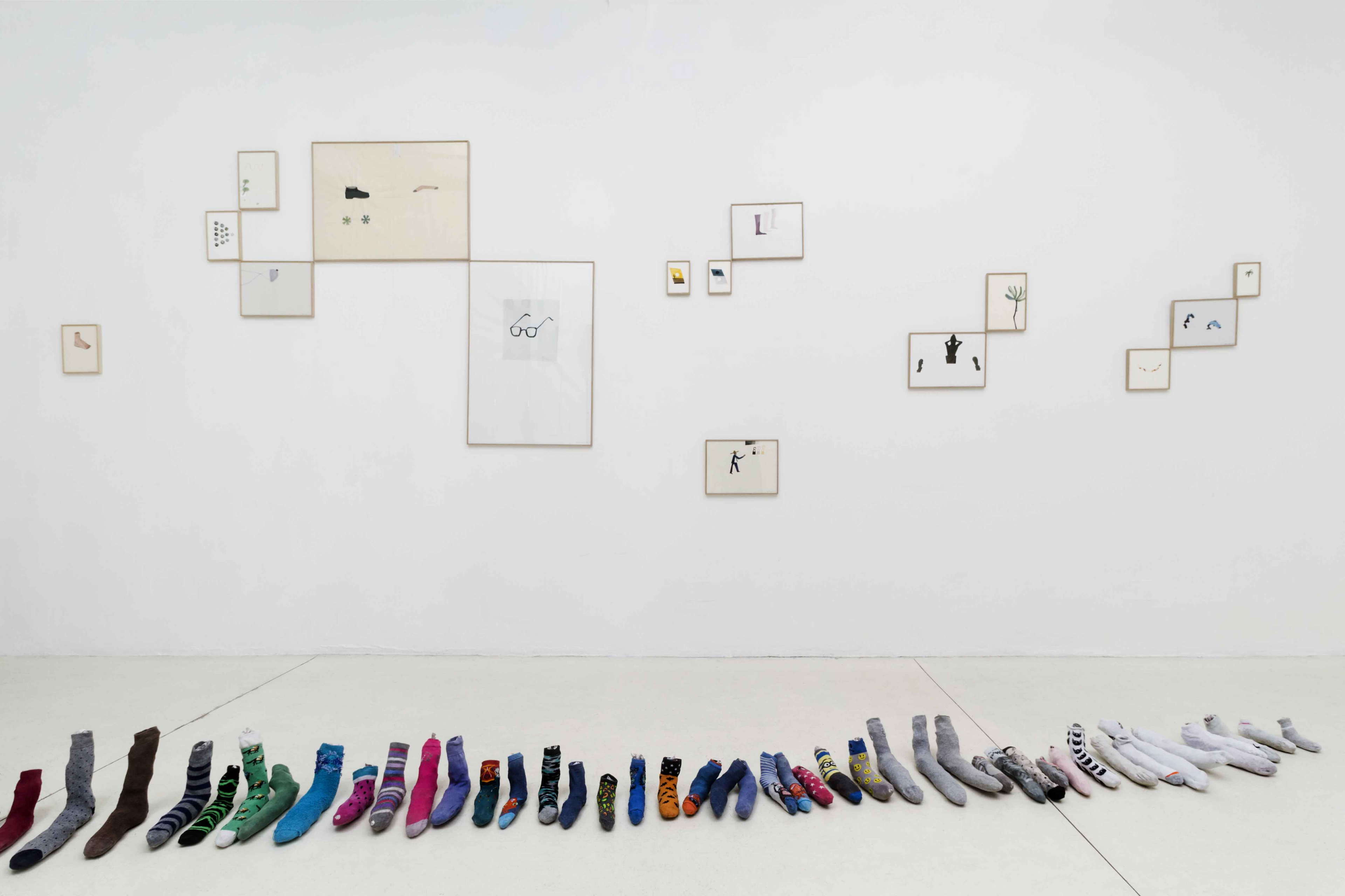 Die Ecke Arte Contemporáneo, Santiago de Chile.  Installation view. The crossword Nº 13.692 is used to reorganize and rename a group of drawings, presented along *Was Machen Sie da?* a collection of lost socks.