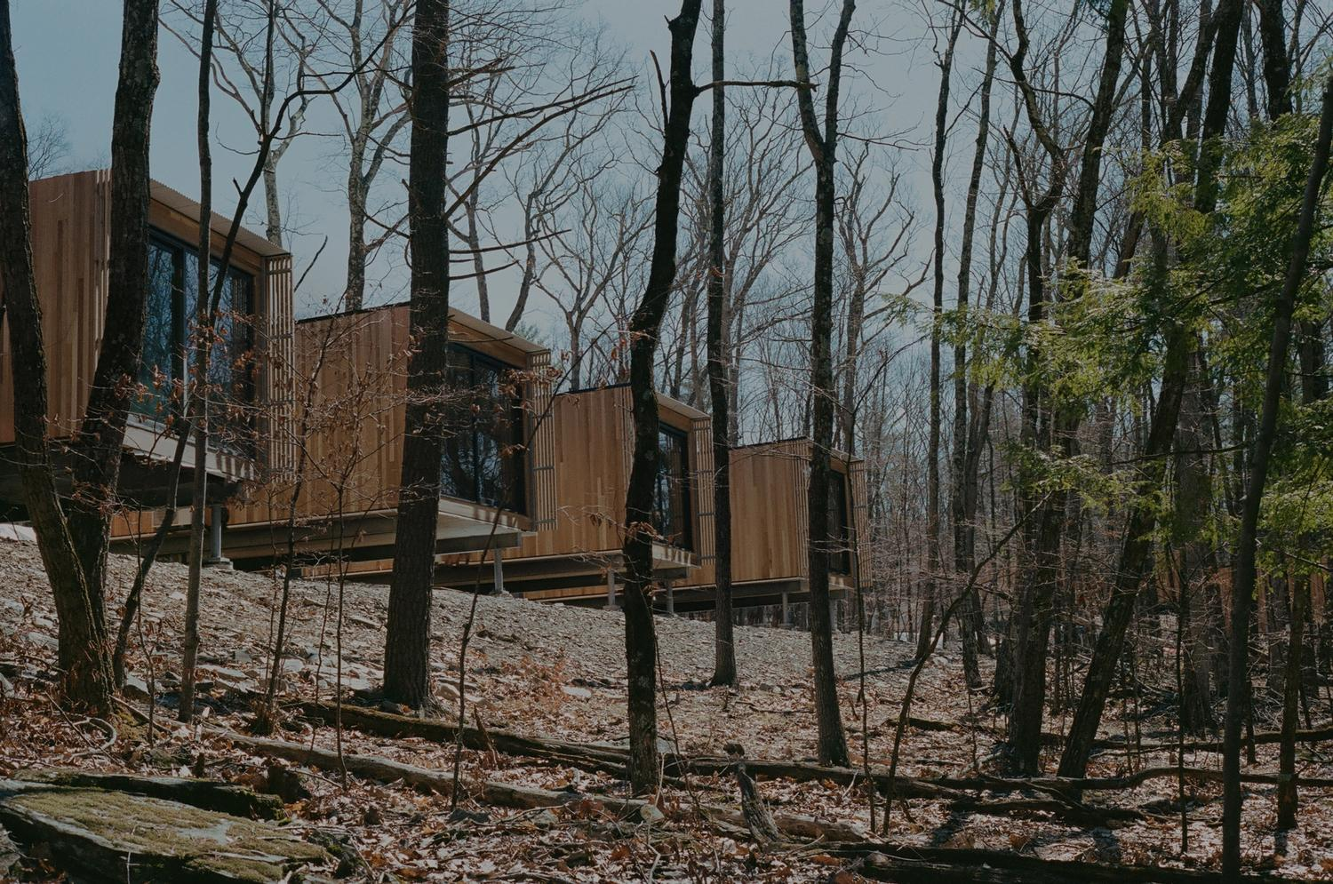 Modernist cabins in the woods in upstate New York, with luxury spa, restaurant and hiking trails.