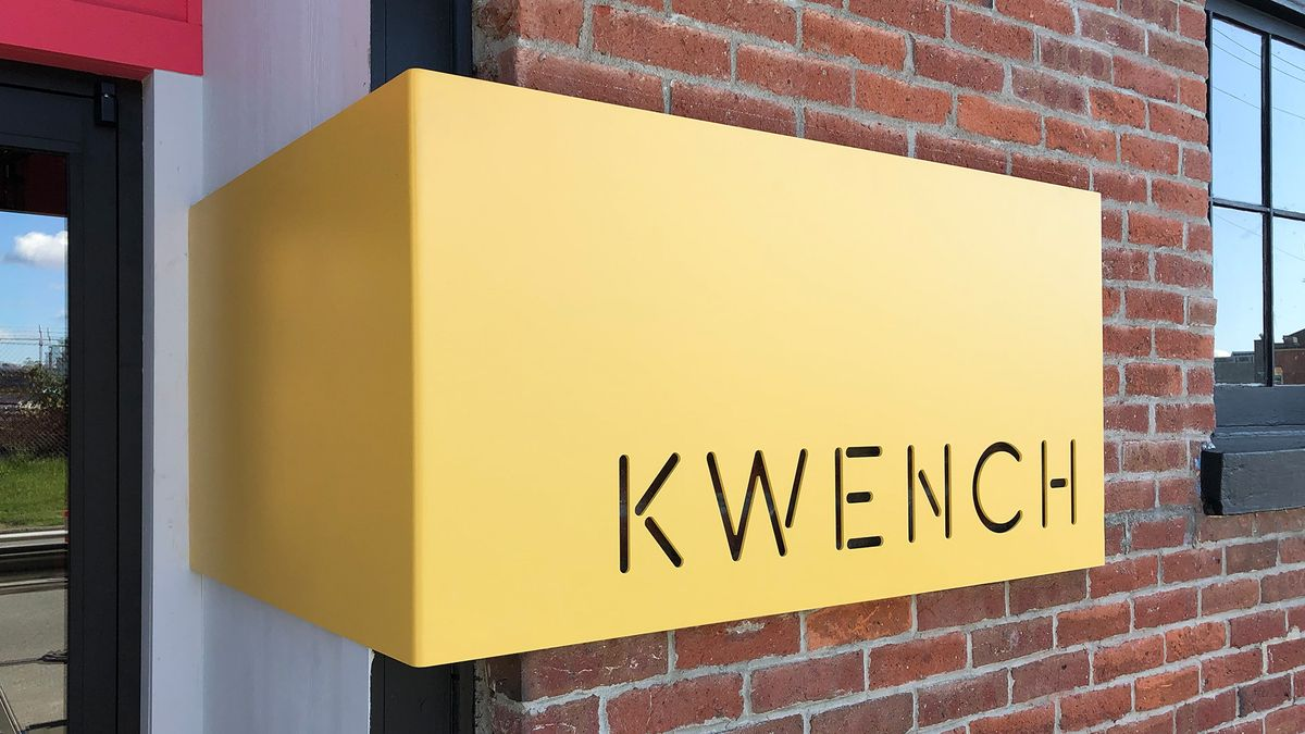 KWENCH office exterior signage, permanent, steel, powder coat