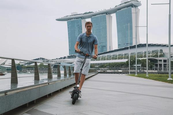 Man riding a long-range electric scooter in Singapore