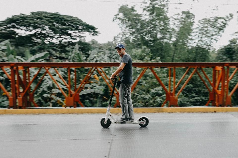 Man riding electric scooter to work