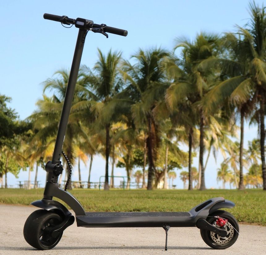 Mercane electric scooter Widewheel standing in a park