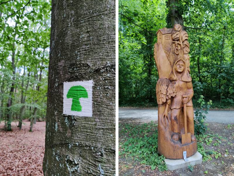 Trail markings and wooden statues