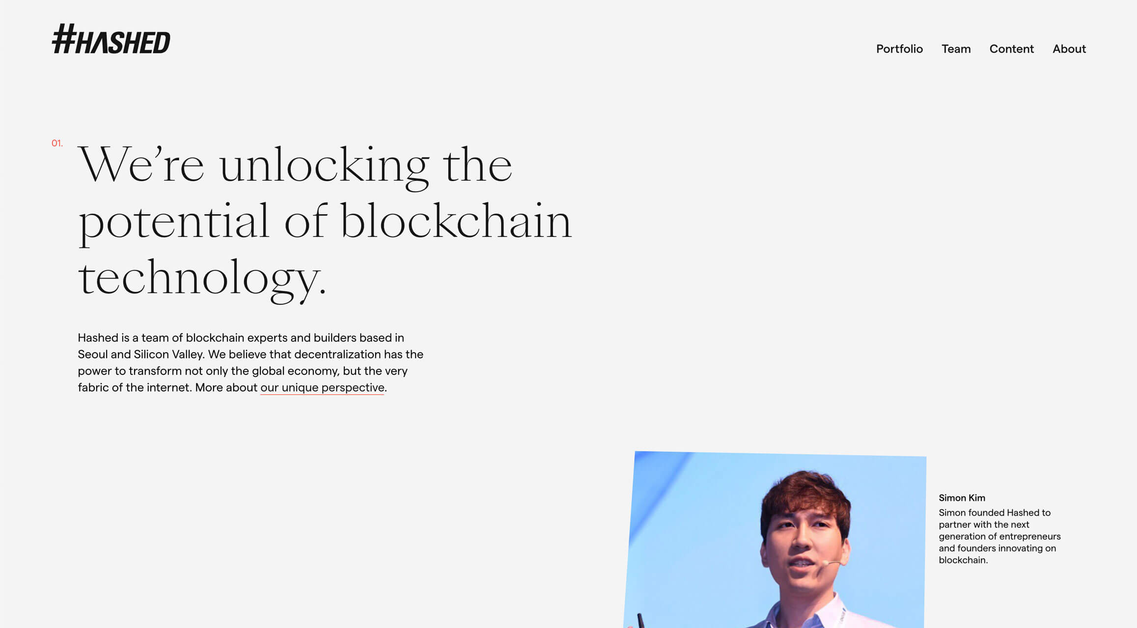 """A screenshot of the Hashed homepage. It features a large title reading """"We're unlocking the potential of blockchain technology"""", while an image of Hashed CEO Simon Kim is skewed to the right."""