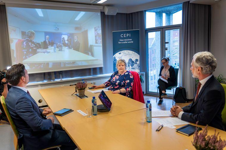 Statsminister Erna Solberg (H) og utviklingsminister Dag Inge Ulstein (KrF) i møte med CEPIs visedirektør  Frederik Kristensen.