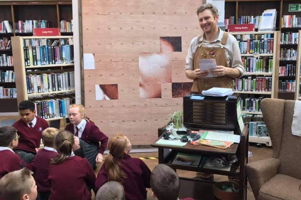 Chris talking to a school group in Barrow Library