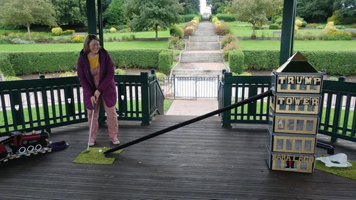 Woman playing golf in bandstand