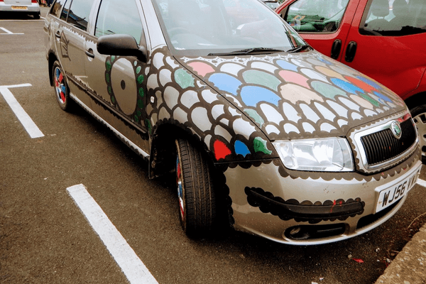 Car painted with scales