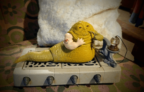 Jabba the Hutt toy with clay muscled arm with tattoo