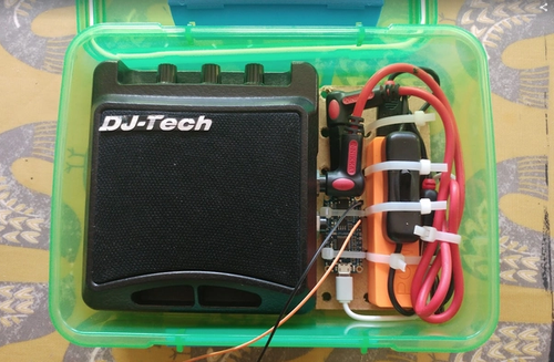 box with speaker, switch, circuit board and battery.