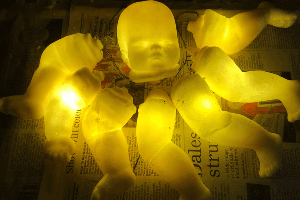 Glowing wax baby head arms and legs