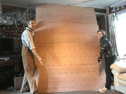 Chris and Jennie with large plywood board.