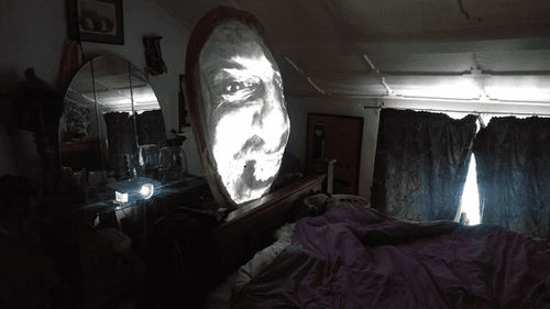 Gill witch face projection in bedroom