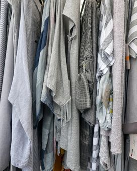 Shot of second hand clothes on a rail