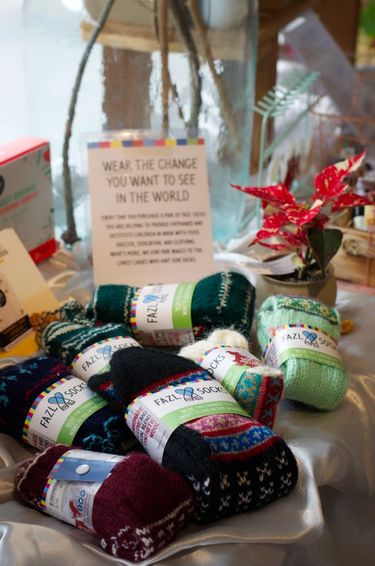 Colourful woollen socks from a sustainable range displayed in a shop