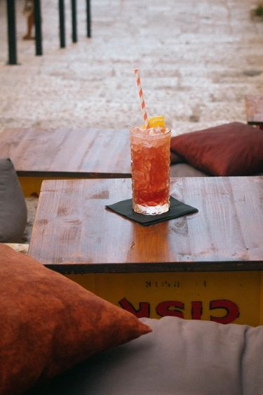 Image of a drink on repurposed drink creates to make a table.