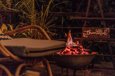 Outdoor fire at the Nesting Table of glamping boutique hotel The Birdhouse El Nido, Philippines