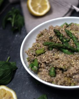 A plate with buckwheat and asparagus surrounded by lemon and mint