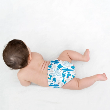 Baby in an eco diaper with a cactus pattern