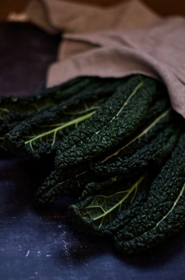 Kale leaves wrapped in a linen cloth