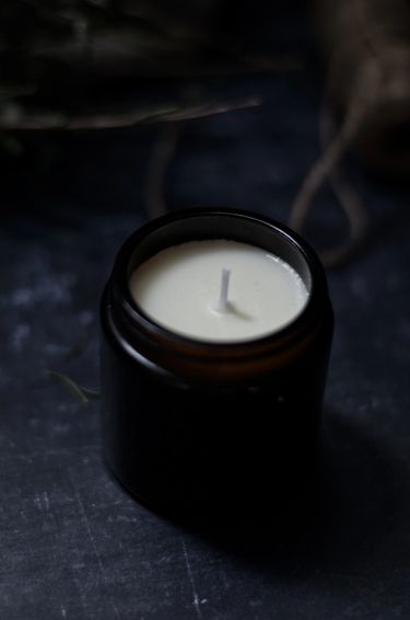 Soy wax candle in a amber candle jar