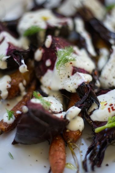 Close up of a carrot and beet salad with yoghurt dressing