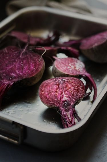 Seasoned raw beetroot slices in a dish