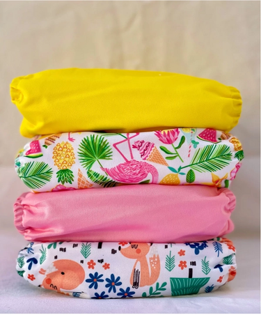Sustainable colourful nappies stacked on top of each other.