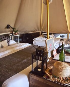 Bed in a tent at glamping boutique hotel The Birdhouse in El Nido, Philippines