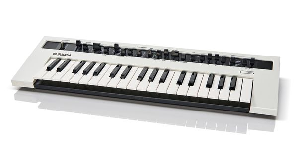 The Yamaha Reface CS synth on a white table.