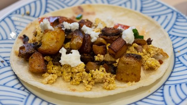 A breakfast taco with assorted ingredients