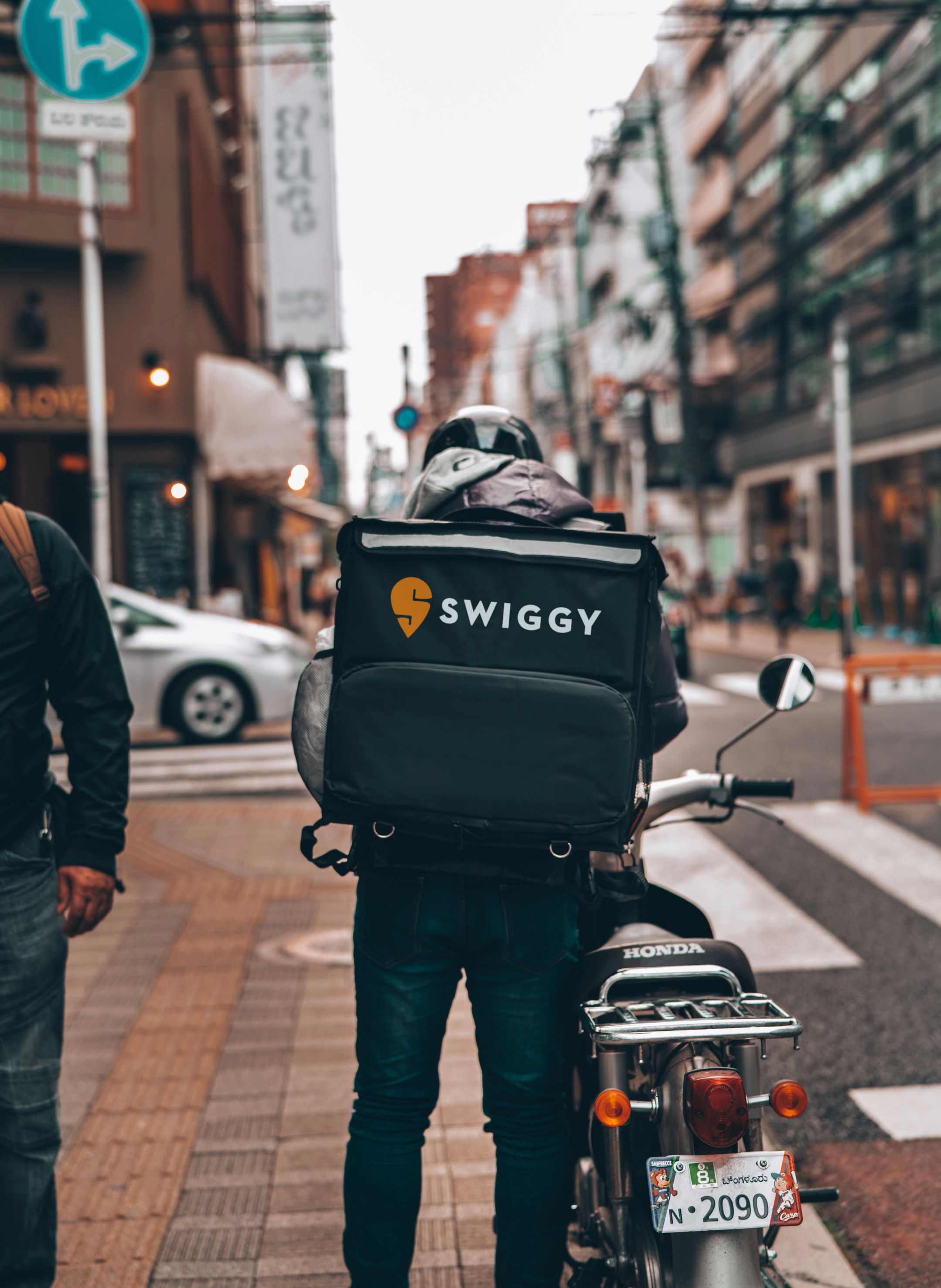 A rider on their way to deliver food for Swiggy