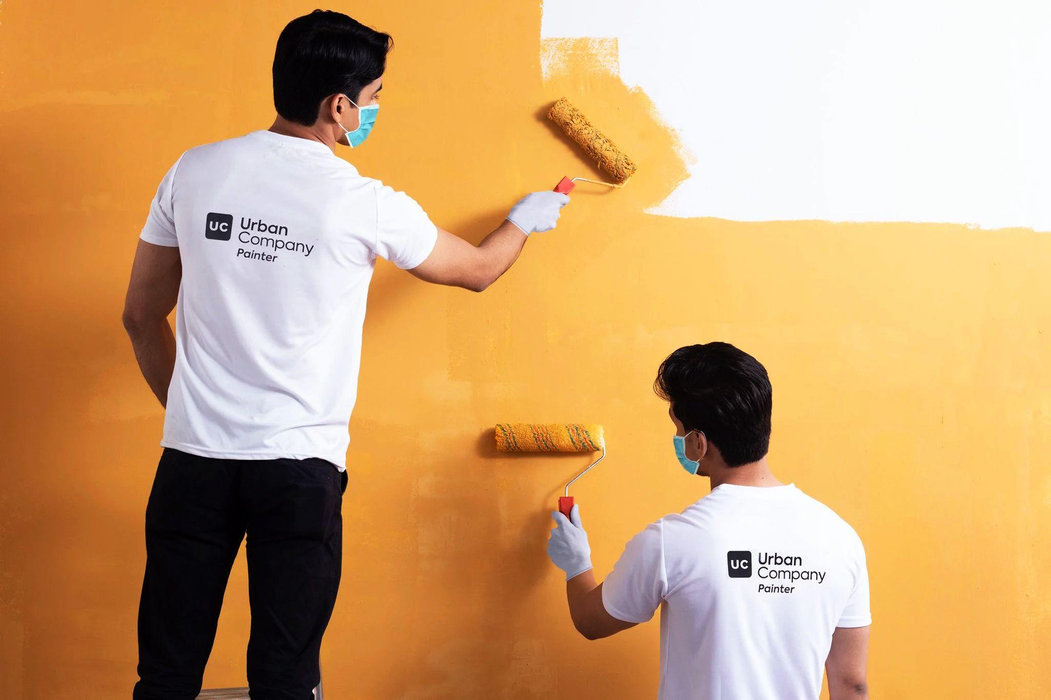 Urban Company service providers painting a wall