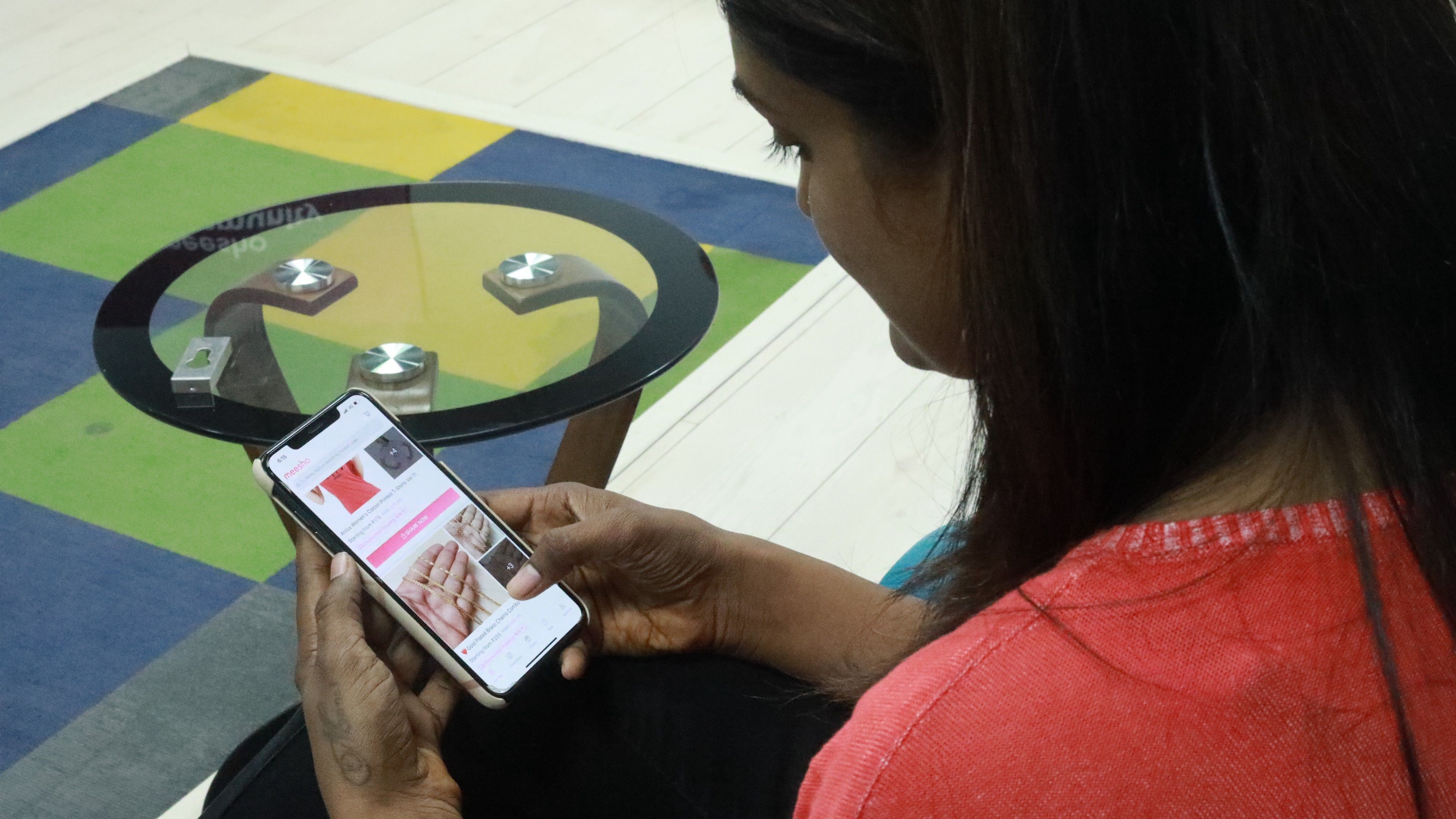 A woman using the Meesho app