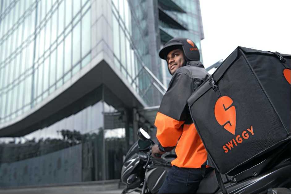 Swiggy delivery rider on a motorbike